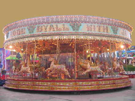 An image of a full sized Victorian carousel, one of the most ornate and spectacular rides available on the British fairground.